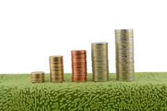 Stacks of coins white background Royalty Free Stock Images