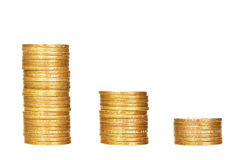 Stacks of coins on white Stock Images