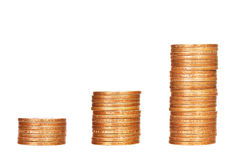 Stacks of coins on white Stock Photo
