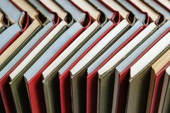 Stacks of colored books on a wooden table. concept of reading habits.  royalty free stock photo