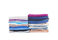 Stacks of colored clothes isolated. Stack of colored clothes isolated on white background Stock Photo