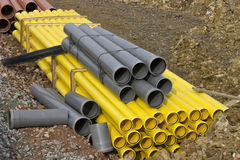 Stacks of colored pvc pipes Royalty Free Stock Photo