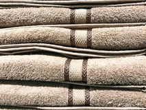 Stacks of colored terry towel on shelves. Studio Photo Royalty Free Stock Photos