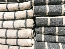 Stacks of colored terry towel on shelves. Studio Photo Stock Image