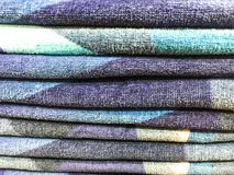 Stacks of colored terry towel on shelves. Studio Photo Royalty Free Stock Photo