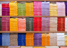 Stacks of colored terry towels on the shelves in a shop Stock Photo