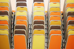 Stacks of colorful chairs Stock Image