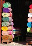 Stacks of colorful fabric for sale. Tall stacks of colorful fabric is for sale at a store in Cuzco, Peru royalty free stock photo