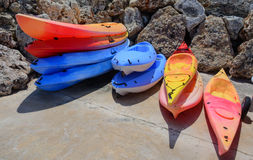 Stacks of colorful kayaks Stock Image