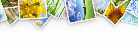 Stacks of colorful photos. On white Royalty Free Stock Photography