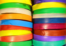 Stacks of colorful plastic jar caps Royalty Free Stock Photography