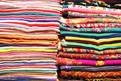 Stacks of colorful scarfs and fabrics background Stock Images