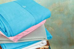 Stacks colourful bed linen textiles clothing background pile concept Royalty Free Stock Photography