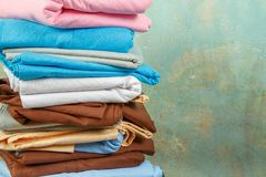 Stacks colourful bed linen textiles clothing background pile concept Stock Images