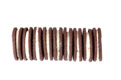 Stacks of cookies in horizontal on white background Stock Images