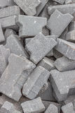 Stacks of cracked concrete pavers background Stock Image