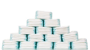 Stacks of diapers stacked in staggered rows isolated on  white. Royalty Free Stock Photos