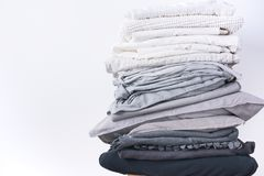 Stacks different shades grey white black bed linen stock image