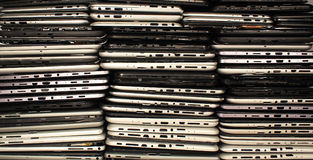 Stacks of disassembled tablets and smartphones. Plastic cases with boards and connectors. Electronics waste concept background royalty free stock photos