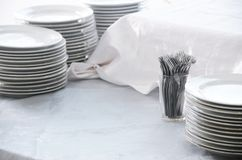 Stacks of Dishes and Forks stock photography