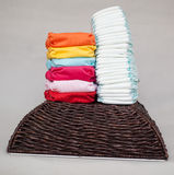 Stacks of disposable diapers and modern cloth diapers Royalty Free Stock Photography