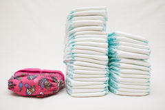 Stacks of disposable diapers and modern cloth diapers Stock Photo