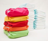 Stacks of disposable diapers and modern cloth diapers Royalty Free Stock Photos