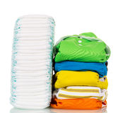 Stacks of disposable and reusable diapers tissue isolated on white. Stock Images
