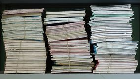 Stacks of documents on a shelf Stock Photo
