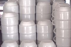 Stacks of empty clean white coffee cups on a buffet in a cafe. stock images
