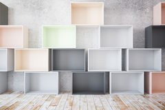 Stacks of empty colorful boxes. Stacks of empty colroful boxes in room with concrete wall and wooden floor. Mock up, 3D Rendering Stock Images