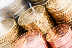 Stacks of Euro coins. A closeup of stacks of Euro coins in difference denominations Stock Photography