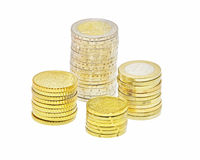 Stacks of euro coins. Four stacks of euro coins isolated on white background Royalty Free Stock Images