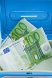 Stacks of  euro coins and banknotes in a cash box Royalty Free Stock Image