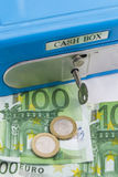 Stacks of  euro coins and banknotes in a cash box Stock Photography