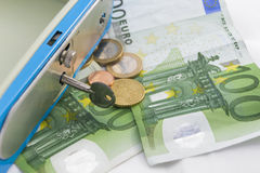 Stacks of  euro coins and banknotes in a cash box Stock Image