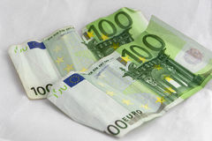 Stacks of  euro coins and banknotes Stock Photos