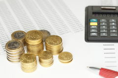 Stacks with euro coins. And calculator on list Royalty Free Stock Photography
