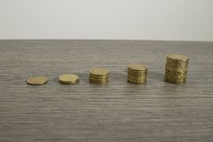 Stacks of euro coins on a decorated wood table royalty free stock images