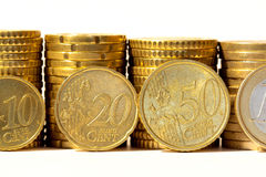 Stacks of euro coins isolated on white Stock Image