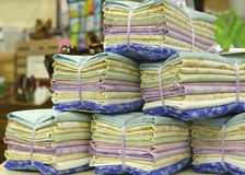 Stacks of Fat Quarters. Quilting fabric, in blues, lavender, greens and yellow bundled for sale royalty free stock photo