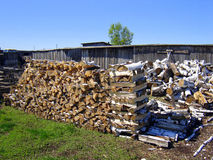 Stacks of firewood. A background of stacked firewood Stock Images
