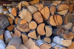 Stacks of firewood outdoors. Pile of cut fruit tree logs. stock photos