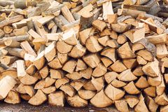 Stacks of firewood in the sawmill. Pile of firewood. royalty free stock images