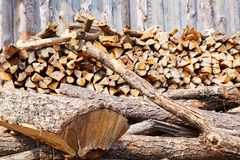 Stacks of firewood in the sawmill. Pile of firewood royalty free stock photos