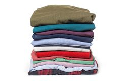 Stacks of folded clothes on white background royalty free stock photography