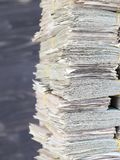 Stacks of folded paper money. Worn and worn out, ready for disposal and destruction royalty free stock photography