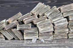 Paper money. Stacks of folded paper money worn and worn out, ready for disposal and destruction royalty free stock photo