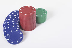 Stacks of gambling chips against white background Royalty Free Stock Image