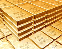Stacks of gold bars. Stacks of pure gold bars on piles of bullion Stock Images